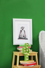 Picture of cute monkey and stand with books in child's room
