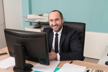 Bald Confident Businessman Smiles Barely