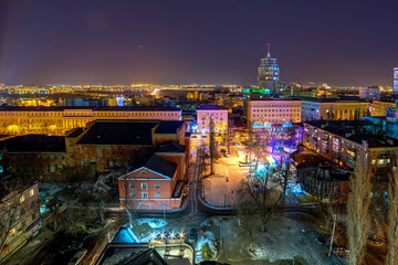 Night panoramic aerial winter cityscape view of Voronezh city, houses, night lights