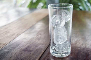 ice tube in glass on table