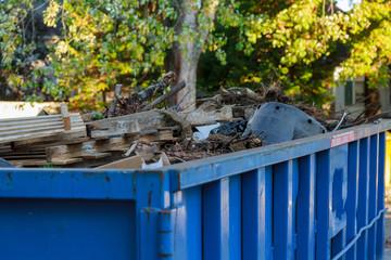 Industrial dumpster filled with debris.