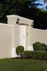 Wall with modern entrance gate