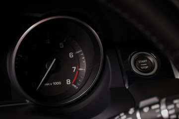 Car interior detail. Engine start and stop button.