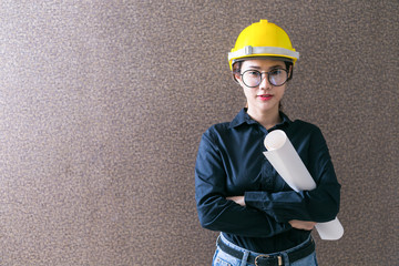 Business woman engineer developer holding blueprint on background.