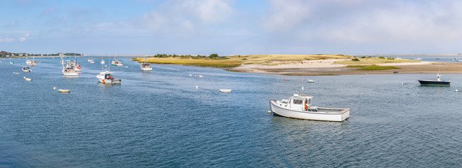 VIew of Multiple Fishing Boats Parked on Channel