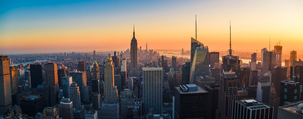 Aerial panoramic cityscape view of Manhattan, New York City at Sunset