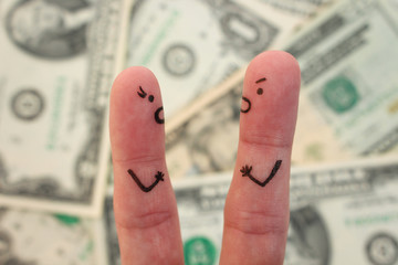 Fingers art of couple on background of money.  Concept of man and woman yelling at each other.