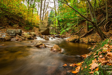 Waterfall in an autumn forest as a time exposure