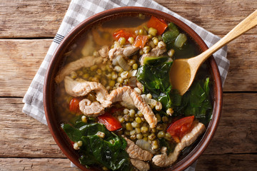Philippine mung beans soup with pork closeup in a bowl. horizontal top view
