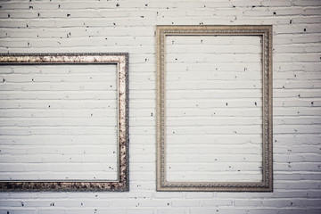 vintage frames on white brick wall. background.