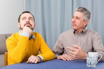Mature father and son serious talk
