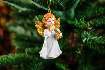 Beautiful Christmas tree decoration toy in the form of redhead angel