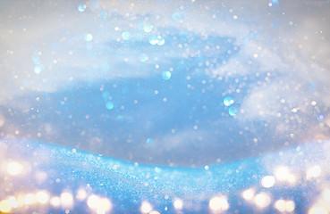 glitter vintage lights background. light blue and silver. de focused