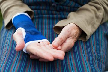 Senior hand with elastic bandage isolated