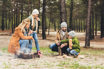 family making campfire