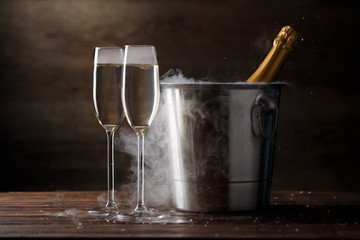 Festive image of two wine glasses with sparkling wine