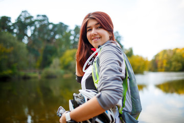 Photo of happy woman with backpack and bicycle helmet