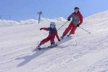 mit Papa beim Skifahren