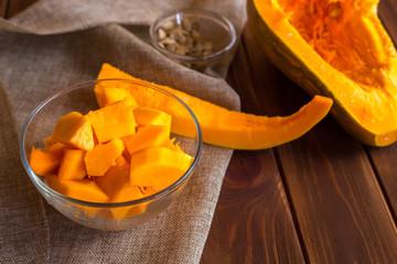 Preparing the pumpkin porridge on a dark wooden background