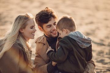 family spending time on beach