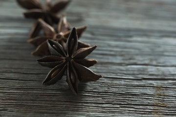 Star anises on wooden table