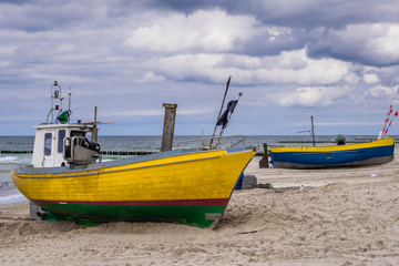 Fishing boats on a beach in Rewal, Poland