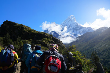 Four Trekkers Walking on Everest Highway While Seeing Mount Ama Dablam, Everest Base Camp Trek From Tengboche to Dingboche , Nepal