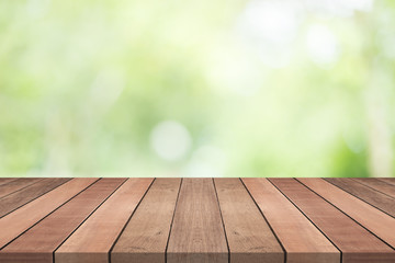 Wood table top on nature green blurred background,for montage your products