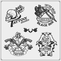 Vector set of tattoo salon labels, badges and design elements. Tattoo studio emblems with professional equipment, rose, gun and skull.