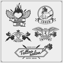 Vector set of tattoo salon labels, badges and design elements. Tattoo studio emblems with professional equipment.