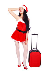 happy woman in Santa Claus clothes with suitcase isolated on white background