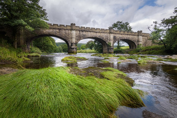 Kings bridge at Bolton Abbey over river Wharfe beautiful picturesque English countryside