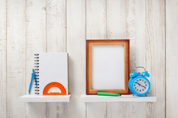 school supplies and tools on wooden shelf