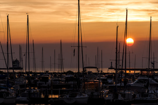 Sunset View of Lorain Harbor Lighthouse & Boats Along Lake Erie - Lorain, Ohio
