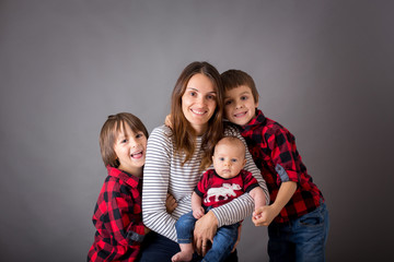 Family christmas portrait, isolated on gray, studio image