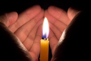 Candle light in hands