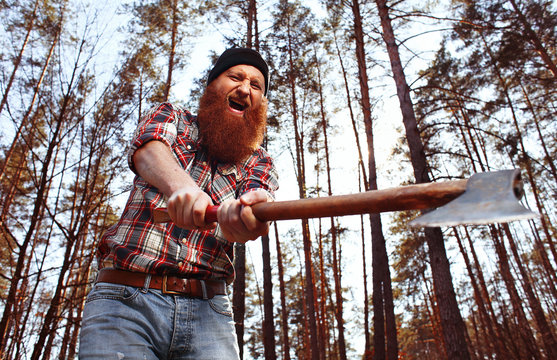 a lumberjack works with an axe in the forest