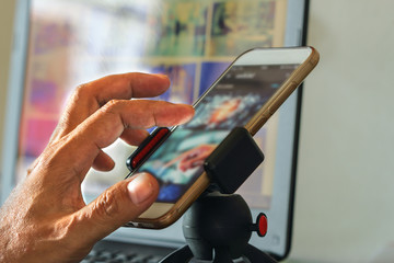 Men hand presses on touch screen digital of smartphone