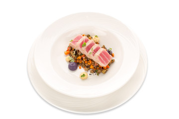 Molecular modern cuisine tuna with lentil and vegetable isolate. Seared Tuna raw fish Asian style on a white plate