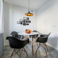 Round table and black chairs