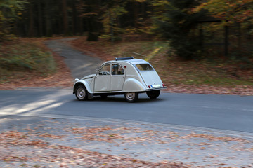 french classic car called duck on the road