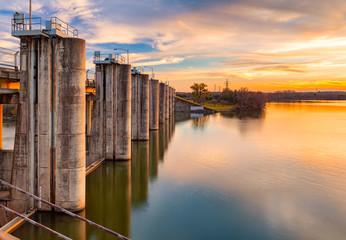 The sun sets over Longhorn Dam in Austin, Texas