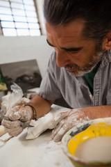 Close-up of attentive man molding sculpture