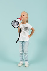 Attractive cute girl in light clothes hold megaphone