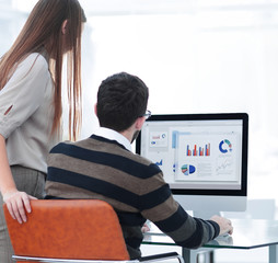 employees analyzing the marketing graphics