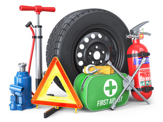 A set of automotive accessories. Spare wheel, fire extinguisher, first aid kit, emergency warning triangle, jack, tow rope, wheel wrench, pump
