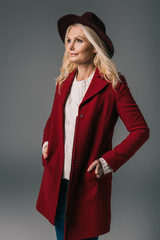 mature woman in red coat and hat
