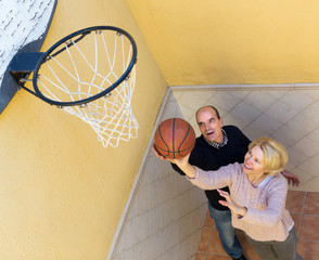 Elderly couple throwing the ball