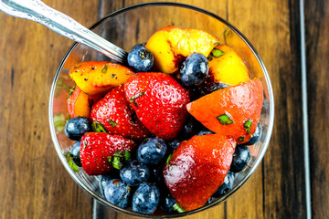 A bowl of fresh fruit with mint
