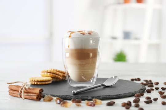 Glass with latte macchiato on blurred background